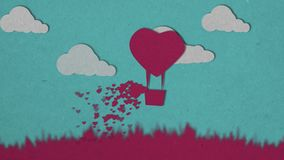 Love and valentine day. Pink hot air balloon and white clouds flying over grass with heart float on blue sky. Hearts. Emission from the basket. Carton animation royalty free illustration