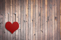 Love Valentine heart and grunge wooden background. Love Valentine heart hanging on vintage wood wall Royalty Free Stock Images