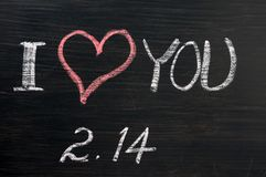Love with valentine 's date drawn. In chalk on a chalkboard Royalty Free Stock Images