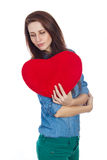 Love and Valentine's Day beautiful brunette holding a red heart in hands isolated on white background Royalty Free Stock Image