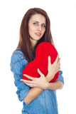 Love and Valentine's Day beautiful brunette holding a red heart in hands isolated on white background Stock Photos