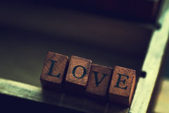 Love or Valentine`s Day Concept with Wooden Letters LOVE in an O Royalty Free Stock Images