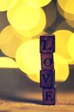 Love or Valentine`s Day Concept with Wooden Letters LOVE on a wo Royalty Free Stock Photo