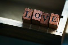 Love or Valentine`s Day Concept with Wooden Letters LOVE on a wo Royalty Free Stock Images