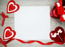 Valentine`s day heart gift box and sweet lollipop. Love valentine`s day heart gift box lollipop and greeting card with copy space Royalty Free Stock Photos