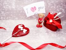 Valentine`s day heart gift box teddy bear and sweet lollipop. Love valentine`s day heart gift box teddy bear lollipop and greeting card Stock Photography