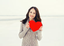 Love, valentine's day and people concept - girl with big red heart Royalty Free Stock Image