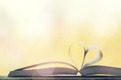 Love, valentine`s day or reading concept with heart shaped book Royalty Free Stock Photography