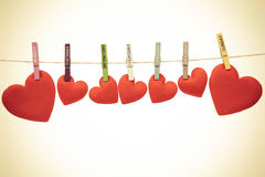 Love for Valentine`s day. Red hearts hung together on the rope with wooden clips with days label on background - Love you everyday concept royalty free stock photos