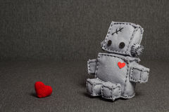 Love and Valentine's Day theme. Robot With Heart. Macro Valentine Toy at blurred backgroung Royalty Free Stock Image
