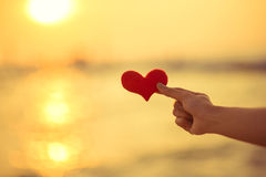 Love for Valentine's day - Two red hearts hung on the rope together with sunset Royalty Free Stock Photo