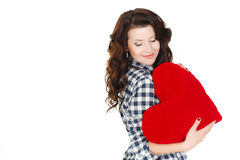 Love and Valentine's Day, a woman holding a red heart. Beautiful brunette woman in love. Royalty Free Stock Image