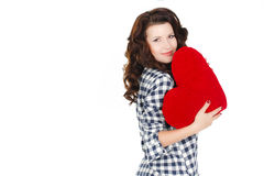 Love and Valentine's Day, a woman holding a red heart. Beautiful brunette woman in love. Stock Photo