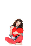 Love and Valentine's Day, a woman holding a red heart. Beautiful brunette woman in love. Royalty Free Stock Photo