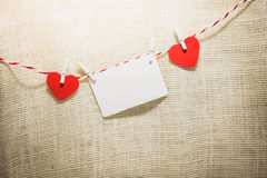 Love Valentine's hearts natural cord and red clips hanging Royalty Free Stock Images