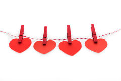 Love Valentine's hearts natural cord and red clips hanging Stock Images