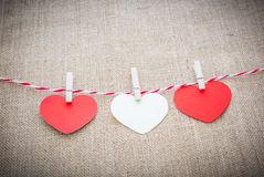 Love Valentine's hearts natural cord and white clips hanging Royalty Free Stock Photography
