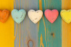 Love Valentine's Hearts on Wooden Texture Painted Board Backgrou Royalty Free Stock Image