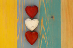 Love Valentine's Hearts on Wooden Texture Painted Board Backgrou Stock Images