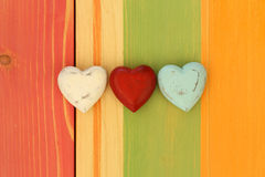 Love Valentine's Hearts on Wooden Texture Painted Board Backgrou Stock Photos