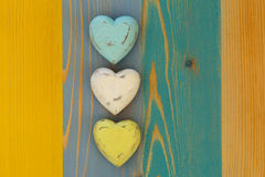 Love Valentine's Hearts on Wooden Texture Painted Board Backgrou Stock Photography