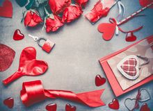 Love and Valentines day concept. Lovely red roses , dating accessories, hearts, book ,lock and keys on gray background, frame. Top view. Layout for greeting royalty free stock image