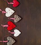 Love or Valentines Day concept. Wooden background with hearts. Flat lay, top view, copy space stock photo