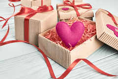 Love, Valentines Day.  Hearts, gift boxes on wood Stock Photography