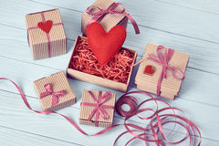 Love, Valentines Day.  Hearts, gift boxes on wood Royalty Free Stock Photos