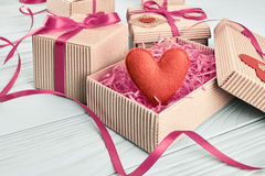 Love, Valentines Day.  Hearts, gift boxes on wood Stock Photos