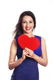 Love and valentines day woman holding heart smiling cute and ado. Valentines Day. Beautiful smiling woman with a gift in the form of heart in his hands. Love and Royalty Free Stock Images