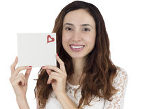 Love and valentines day woman showing a blank sign card. Valentines day woman showing a blank white sign or gift card, isolated on white background. Love and Stock Images