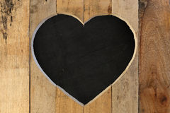 Love Valentines heart wooden frame black chalk board background Royalty Free Stock Photography