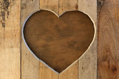 Love Valentines heart wooden frame brown background Stock Photos
