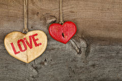 Love Valentines message two wooden hearts sign on rough grey bac Royalty Free Stock Photos