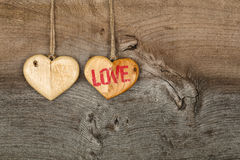 Love Valentines message two wooden hearts sign on rough grey bac Royalty Free Stock Image