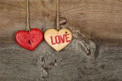 Love Valentines message two wooden hearts sign on rough grey bac Royalty Free Stock Photography