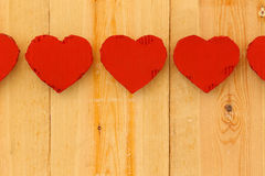 Love Valentines red cardboard hearts on rough pine background Stock Photography