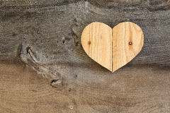 Love Valentines wooden heart on old Elm background Stock Image