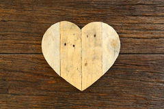 Love Valentines wooden heart on rough driftwood background Royalty Free Stock Image