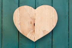 Love Valentines wooden heart on turquoise painted background Stock Images