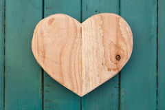 Love Valentines wooden heart on turquoise painted background Stock Photography