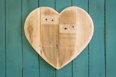 Love Valentines wooden heart on turquoise painted background Stock Photos