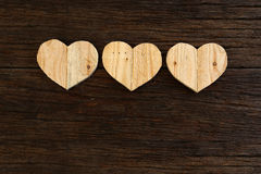 Love Valentines wooden hearts on rough driftwood background Stock Photo