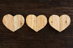 Love Valentines wooden hearts on rough driftwood background Royalty Free Stock Photos