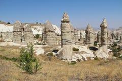 Love valley in Goreme village, Turkey. Rural Cappadocia landscape. Stone houses in Goreme, Cappadocia. Countryside lifestyle Royalty Free Stock Image