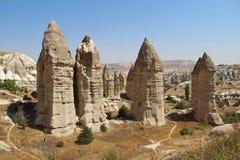 Love valley in Goreme village, Turkey. Rural Cappadocia landscape. Stone houses in Goreme, Cappadocia. Royalty Free Stock Photo