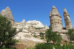 Love valley in Goreme village, Turkey. Rural Cappadocia landscape. Stone houses in Goreme, Cappadocia. Stock Photos
