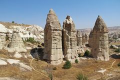 Love valley in Goreme village, Turkey. Rural Cappadocia landscape. Stone houses in Goreme, Cappadocia. Countryside lifestyle Royalty Free Stock Images
