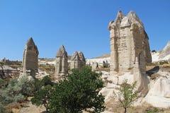 Love valley in Goreme village, Turkey. Rural Cappadocia landscape. Stone houses in Goreme, Cappadocia. Royalty Free Stock Photography